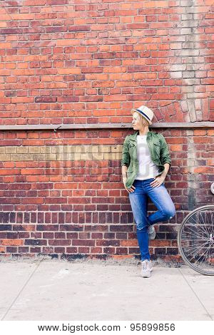 Hipster Woman With Vintage Road Bike In City