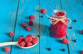 image of mason  - Mason jar with raspberry jam or marmalade and fresh raspberries - JPG