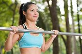 image of pull up  - Strong Asian young woman doing pull - JPG