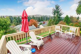 pic of greenery  - Large furnished balcony with a view of greenery - JPG