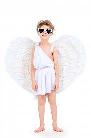 image of cupid  - Cute emotional little boy in a costume of angel - JPG