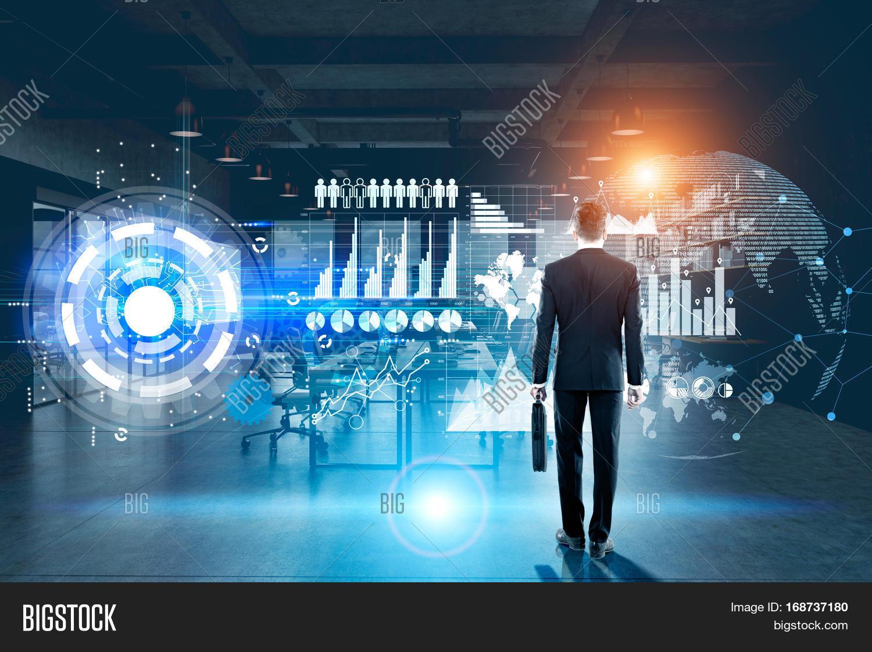 Technology Management Image: Back View Businessman Holding Image & Photo