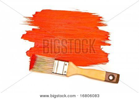 Red paint and brush on white studio