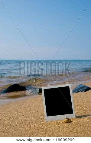 Photo card on sand beach.