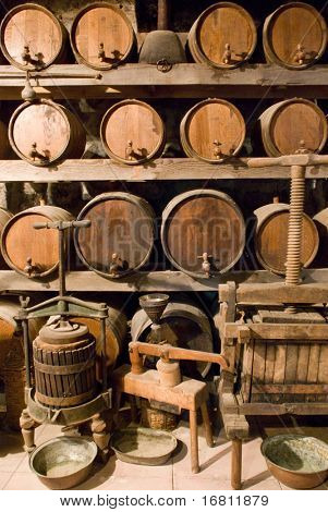 Wine barrels stacked in the old cellar of the vinery