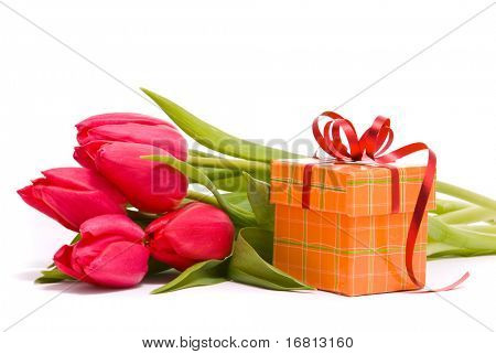 Red tulips and gift box on a white background