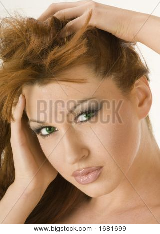 Beautiful Redheaded Woman Running Her Hands Through Her Hair