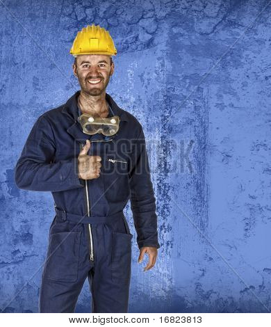 young caucasian labourer portrait with blue grunge background