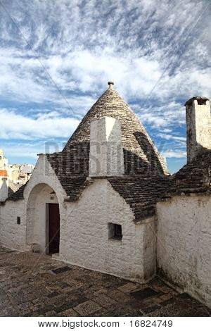 view of trullo in alberobello, italy and blue sky