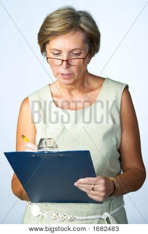 Businesswoman Making Notes
