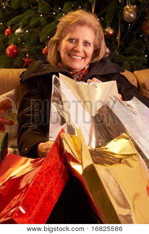 Senior Woman Returning After Christmas Shopping Trip