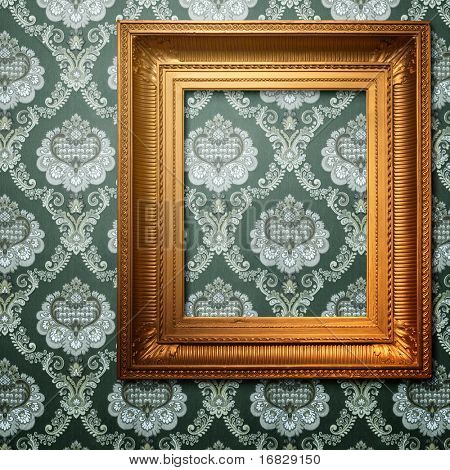 golden frame on vintage wallpaper