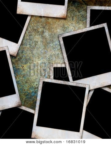 stack of old photos on a grunge background