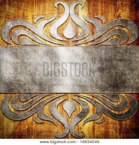 Metal ornament on old wooden background (vintage collection)