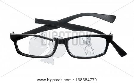 Cheap plastic reading glasses broken on white background.