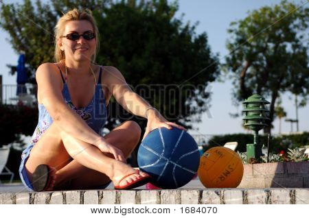 Girl Sitting By Swimming Pool