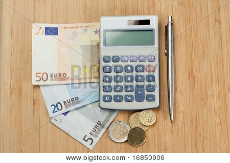 Money With Pen And Pocket Calculator