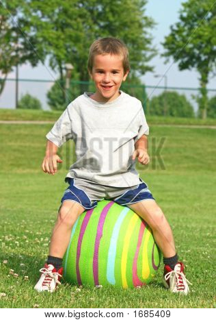 Boy Bouncing On A Ball