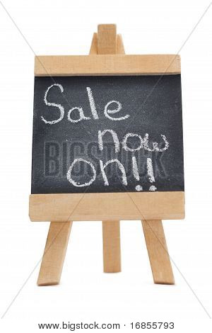 Chalkboard With The Words Sale Now On Written On It