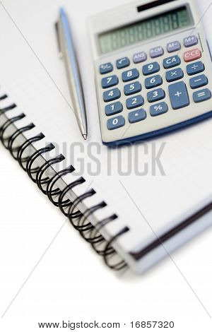 Angled Notebook With Pencil And Pocket Calculator