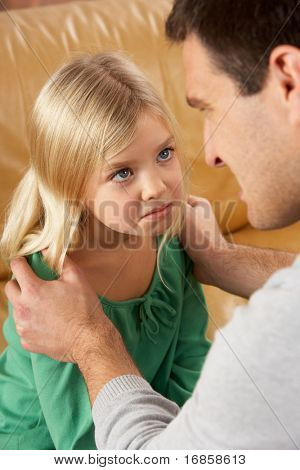 Portrait Of Frightened Daughter Looking At Father