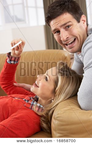 Couple Looking At Result Of Home Pregnancy Test Kit