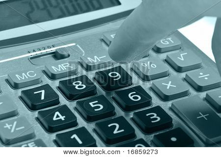 The Calculator And A Hand Of The Man