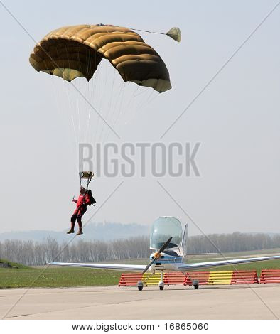 Paratrooper and sports plane in airport Pilsen Line - Czech Republic Europe