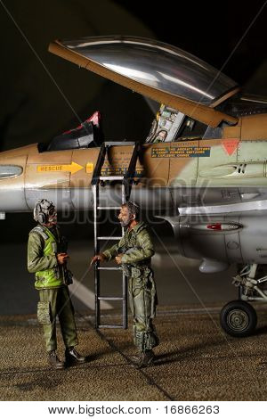Two pilots in front of F16 Eagle - plastic model 1:48 scale - extremely closeup