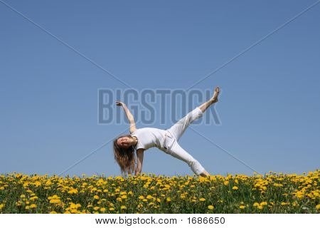 Smiling Young Woman Exercising In Dandelion Field