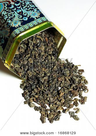 Dry green tea - The tea plant is commonly used in Chinese herbalism, where it is considered to be one of the 50 fundamental herbs.  Ornament in dose is noname folk art.