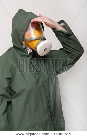 Woman wearing gas mask and protective suit.