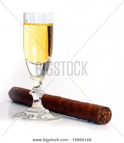 Brandy and cuban cigar - still-life on light grey background