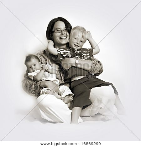 Monochrome studio shot of loving mother holding babies