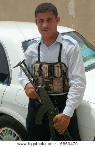 An Iraqi Security Officer With Akm Assault Rifle