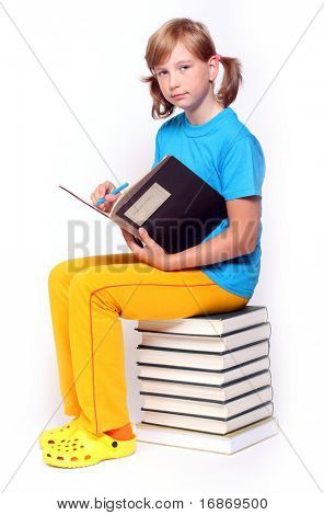 Portrait of a pretty girl with books