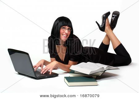 Portrait of a attractive business girl working on notebook with opened book.