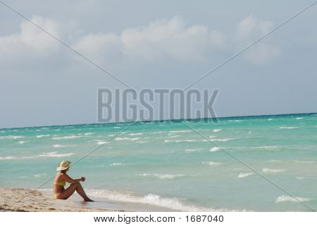 Woman Relaxing On The Ocean Shore