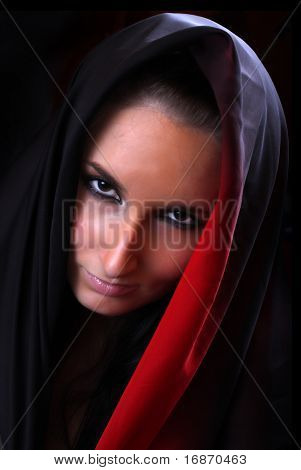 Mysterious beautiful woman. Low key lighting studio shot. Great image for calendar.