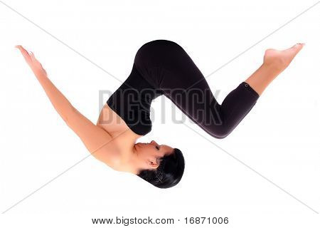 Attractive girl in black sport clothes represents letter W