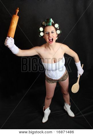 Screaming militant feminist with rolling pin. Humorous image. Great for calendar.