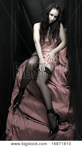 Low key lighting studio shot young beautiful Gothic Girl on pink background. Great for calendar.