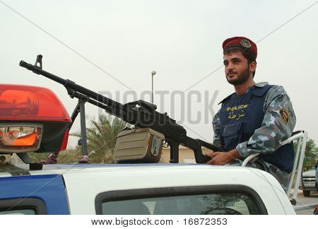 Iraqi Police Swat Officer with PKM machine gun.