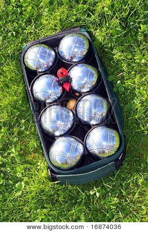 Bocce balls on a green grass.