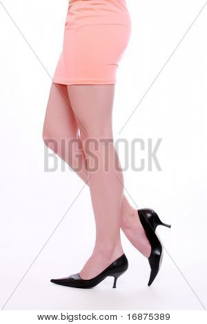 Beautiful long slim legs on white background. Studio shot great for calendar.
