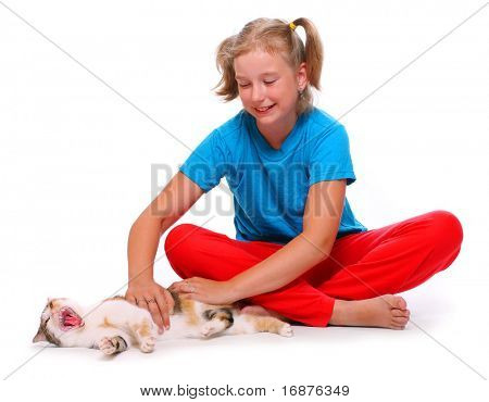 Young girl playing with cat.