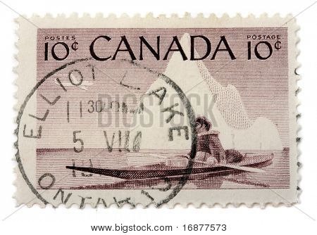 CANADA  - CIRCA 1955: A stamp printed in The Canada shows  image of an Inuit floating in kayak behind polar circle, circa 1955