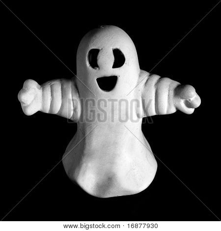 A Scary Ghost on a black background. Unauthorized homemade work (plaster figure - scratchbuild). Great for halloween advertising.