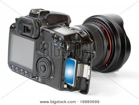 Professional DSLR camera with inserted memory card. Close up with shallow DOF.