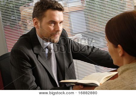 White business man and woman talking in the office -serious